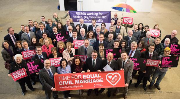 Conor McGinn (front row centre with glasses) with organisations seeking to extend same-sex marriage to Northern Ireland (Stefan Rousseau/PA)