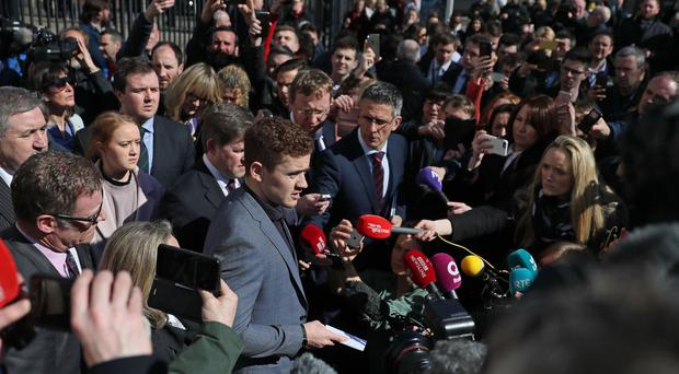 Ireland and Ulster rugby player Paddy Jackson (centre) speaking outside Belfast Crown Court after he was found not guilty of raping a woman (Brian Lawless/PA)