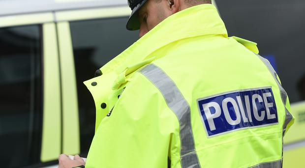 Police conducted searches in west Belfast on Wednesday