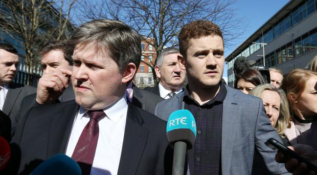 Ulster and Ireland rugby player Paddy Jackson and his lawyer Joe McVeigh speak to the media after the verdict was announced