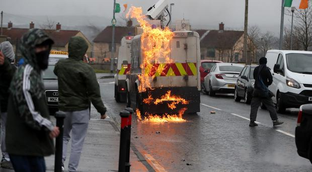 Youths attack police vehicles as they try to prevent an unregistered parade in the Creggan area (Niall Carson/PA)