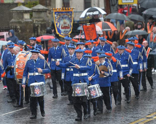 Spectators braved the wet conditions as the annual Junior Orange Association parade took place in Larne yesterday. Senior officers and juniors representing three Belfast districts, Larne and a number of other lodges from across Northern Ireland, accompanied by seven bands, participated in the parade