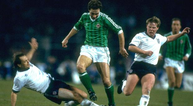 Ray Wilkins (left) tackles Martin O'Neill during England's game against Northern Ireland in 1984