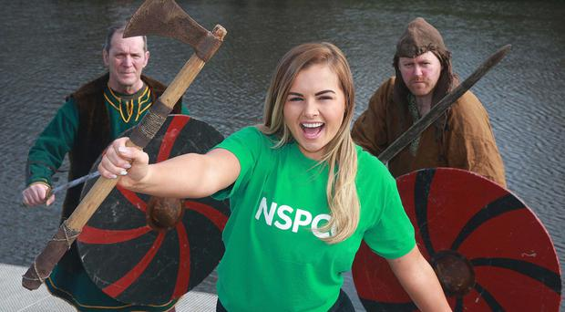 Tiffany Brien joined Ardglass Vikings Peter Keenan and Sean Keogh to launch the Annual Cutters Wharf Viking Boat Race