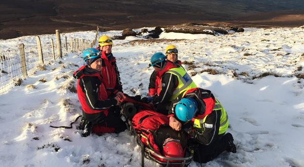 Dramatic rescue and evacuation of injured boy from the snow-covered top of Trostan Mountain in County Antrim