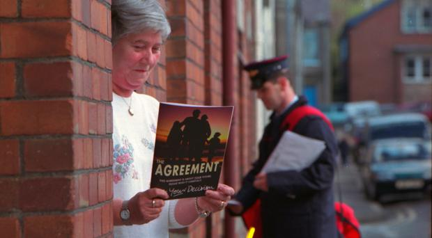 Copies of the Good Friday Agreement are delivered to doors in 1998