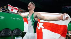 Rhys McClenaghan celebrates winning gold