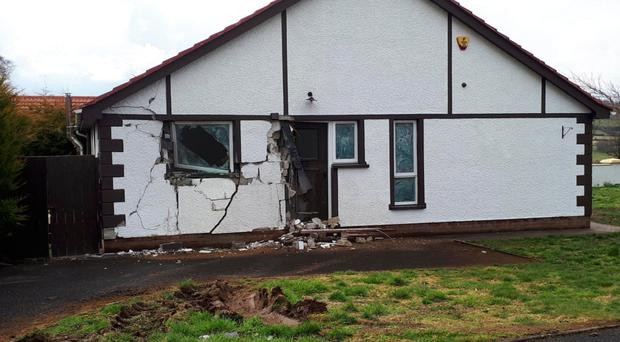 The damage caused when a tractor stolen from a building site was driven into this house in Feeny, Co Londonderry