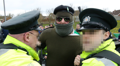 One of the participants in the parade confronts the PSNI in Lurgan