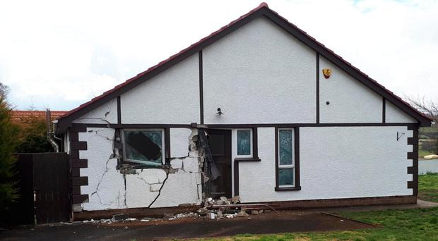A man has been arrested after a tractor was driven into the side of a property.