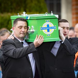Stuart Carson helping to carry the coffin