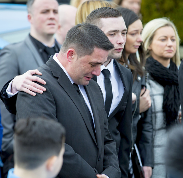 Carter Carson's dad Stuart with mourners