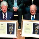 Bill Clinton and George Mitchell after they received the Freedom of the City of Belfast at a ceremony in Ulster Hall yesterday