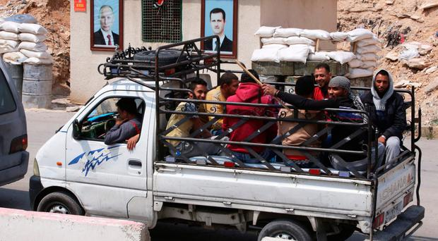 Jaish al-Islam fighters and their family members have been evacuated from the town of Douma, Syria