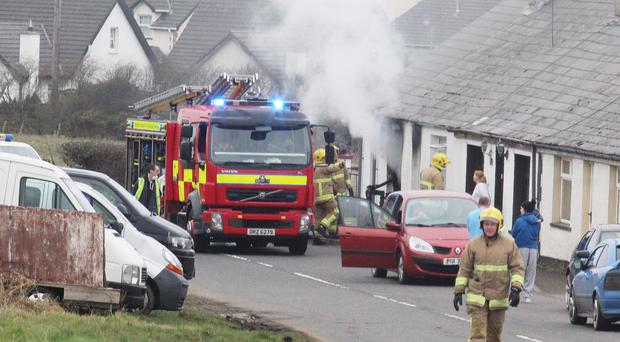 Fire crew and ambulance services at the scene of a house fire on the Magheraboy Road near Portrush on Friday afternoon