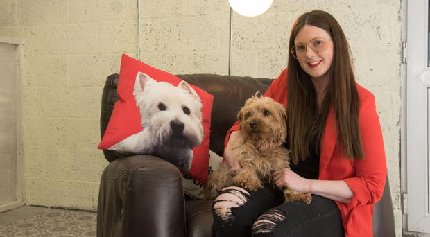 Jackie McKinley with her pooch Charley in the new Hotel For Dogs in Carndonagh
