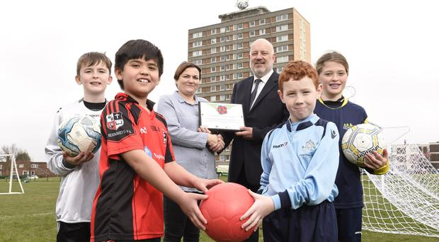 Harvey Moore, Gerald Steele, Coist Walker and Rhian Weatherup from east Belfast with Marlene Dodds (Cregagh Community Association) and Paul Cooper (National Children's Football Alliance)