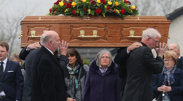 The coffin of Margaret Ann White is carried into Clogherney Presbyterian Church, Omagh