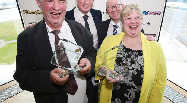 Brother and sister Oliver and Bernie Murphy receive their awards for long service from Northern Ireland manager Michael O'Neill at the Champion Ability Awards ceremony at Titanic Belfast, organised by Usel (Ulster Supported Employment Ltd). Congratulating them is Usel CEO Bill Atkinson