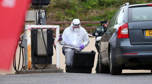 A forensics officer examines the scene following the theft of a ATM
