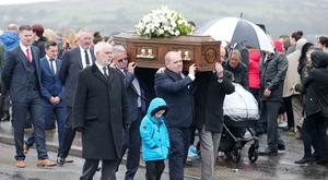 Family and friends at the funeral of Lisa Gow at St Andrew's Church in Glencairn, west Belfast, yesterday
