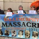 Families of those killed in the 1971 Ballymurphy Massacre protest outside Belfast's Royal Courts of Justice (Lesley-Anne McKeown/PA)