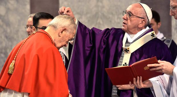 Pope Francis marks the sign of the cross on the forehead of Cardinal Jozef Tomko during Ash Wednesday Mass in Rome earlier this year