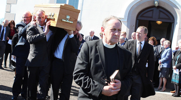 Rev N. McClean of Ramoan Presbyterian Church near Ballycastle at the funeral of Oliver Gibson