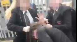 Shocking video footage shows the victim being attacked by two other girls