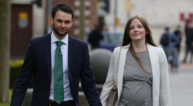 Daniel McArthur and his wife Amy arrive at the Royal Courts of Justice in Belfast (Brian Lawless/PA)