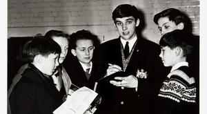 A photograph of a young George Best surrounded by fans, which is expected to sell for about £200