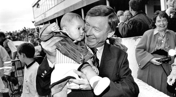 Sir Alex with 16-week-old Aaron Fenwick at the Milk Cup tournament