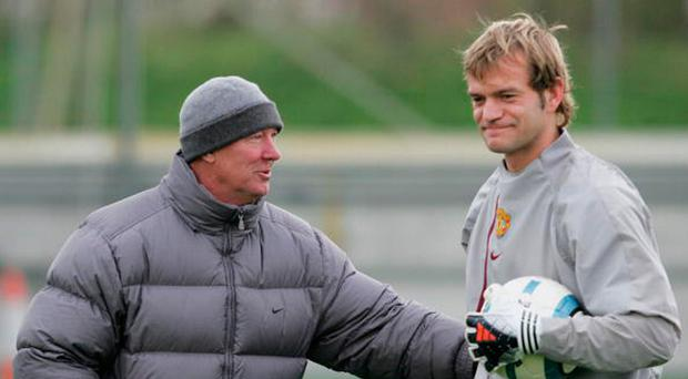 Sir Alex Ferguson with Roy Carroll at Manchester United's training ground in 1994