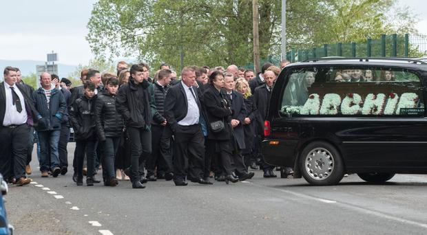 Mourners at the funeral of Colin Archibald