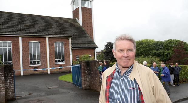 Rev Alistair Bill outside Saintfield Road Presbyterian Church after the arson attack