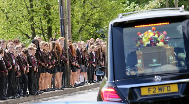 Royal School Dungannon pupils line the route of the funeral for Jack Stafford