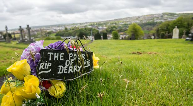 Flowers dedicated to 'The Poor of Derry' are the only indication of the paupers' graves in the City Cemetery