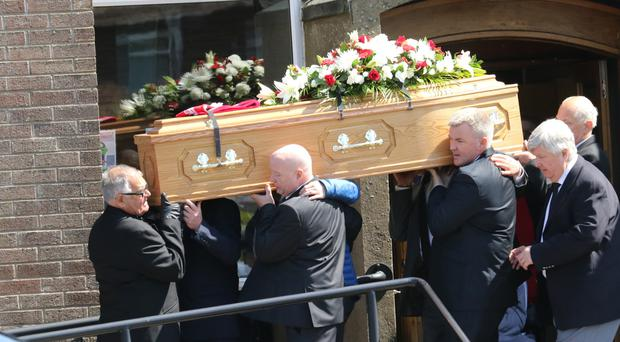 Mourners carrying Connor Murray's coffin