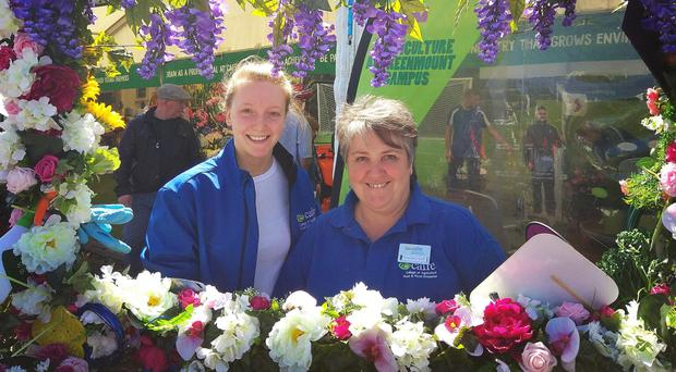 Megan Ingram with floristry lecturer Anne Marie Grant at the Balmoral Show. Megan is a finalist in the Young Florist of the Year at the Chelsea Flower Show, preperations for which continued yesterday
