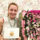 Megan Ingram with the award she picked up at the Chelsea Flower Show