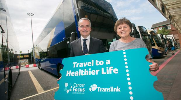 Translink Group Chief Executive Chris Conway and Cancer Focus NI Chief Executive Roisin Foster launch a three year partnership with a new 'Travel to a Healthier Life' campaign