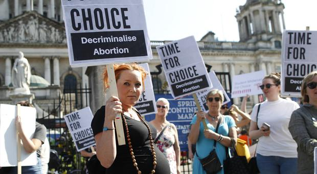 A pregnant woman attends Saturday's abortion rally at Belfast City Hall
