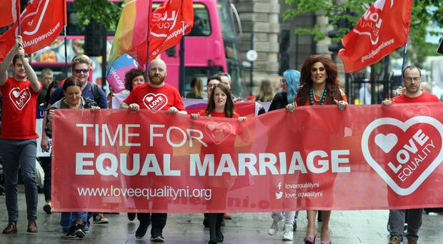 Love Equality campaigners and Belfast Lord Mayor Nuala McAllister demonstrate outside Belfast City Hall