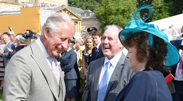 The Prince of Wales meets Martin Court and his wife Pauline (John Stillwell/PA)