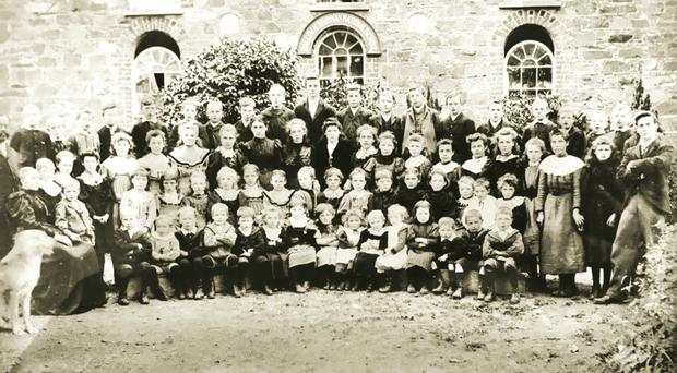 An early 20th century picture at Ballymacbrennan with the pupils, teachers and even the school dog