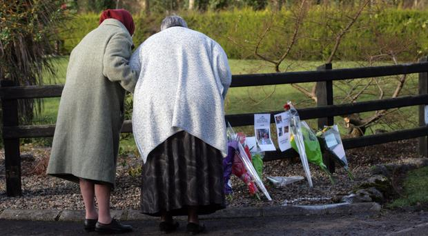 Neighbours and friends lay flowers at scene after fatal crash
