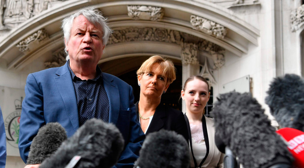 The Northern Ireland Human Rights Commission's (NIHRC) Chief Commissioner, Les Allamby, leaves court