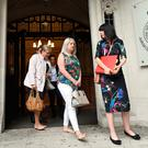 Sarah Ewart (centre) leaves court with Grainne Teggart (right) of Amnesty International, and Sarah's mother Jane Christie