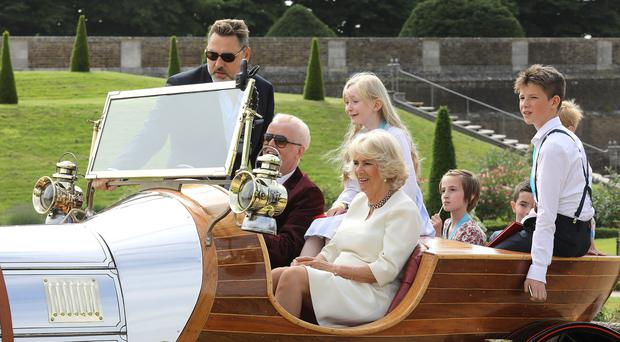The Duchess of Cornwall and Chris Evans depart in 'Chitty Chitty Bang Bang' (Tim Whitby/PA)