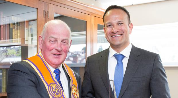 Taoiseach Leo Varadkar being presented with a gift from Grand Master of the Grand Orange Lodge of Ireland, Edward Stevenson